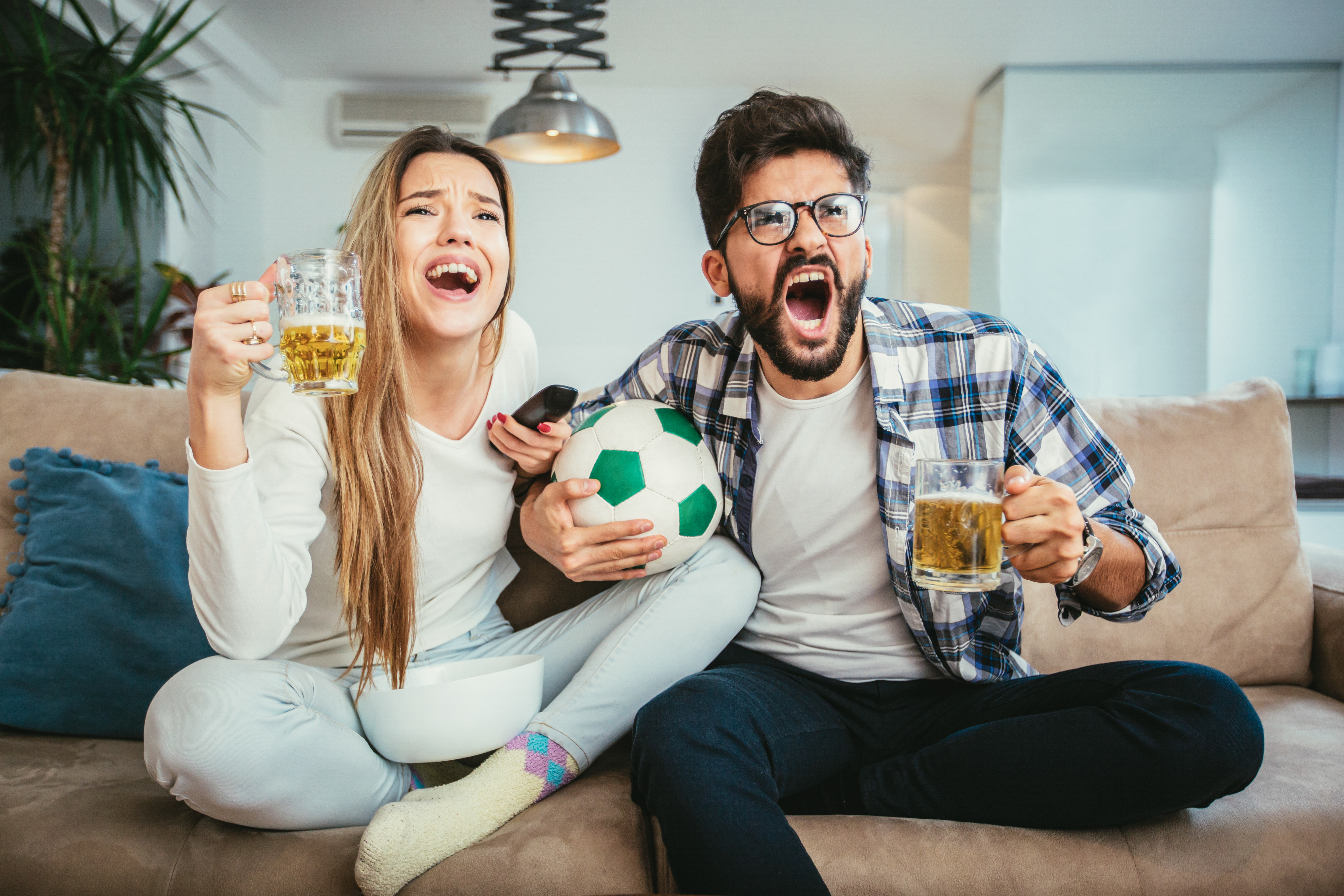friends watching game with beer