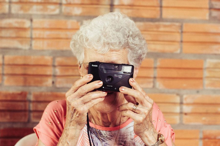 Elderly woman taking profile selfie funny